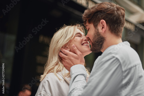 Smiling man is looking at the happy woman