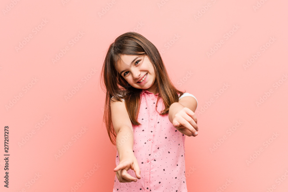 Fototapety, obrazy: Cute little girl cheerful smiles pointing to front.