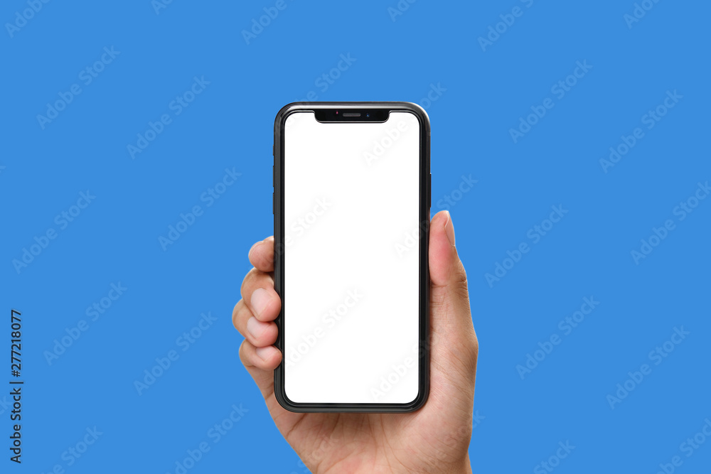 Fototapeta Hand holding the black smartphone with blank screen and modern frame less design on blue colour background