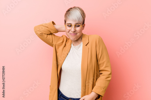 Young caucasian woman wearing a casual business clothes touching back of head, thinking and making a choice Canvas Print