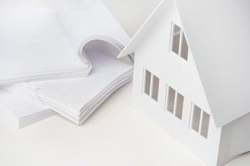 Cottage on a white background. Documents for the construction of the house. Supervision of construction. Development of drawings of the building. Bureau of Architecture. Documents