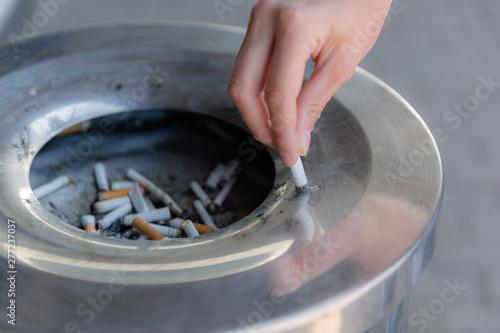 Fotografie, Tablou  Cigarette butts in the urn, close-up.