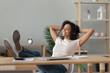 Leinwanddruck Bild - Relaxed african woman wear headphones listening to music at desk