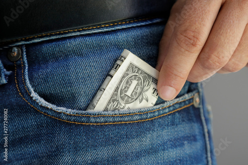 Cuadros en Lienzo One Dollar in a jeans pocket, hand put the bill out