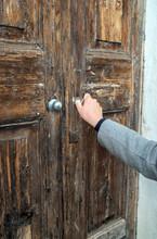 Woman Opening Very Old Wooden Door.
