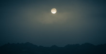 Full Moon Over Mountains In Scotland