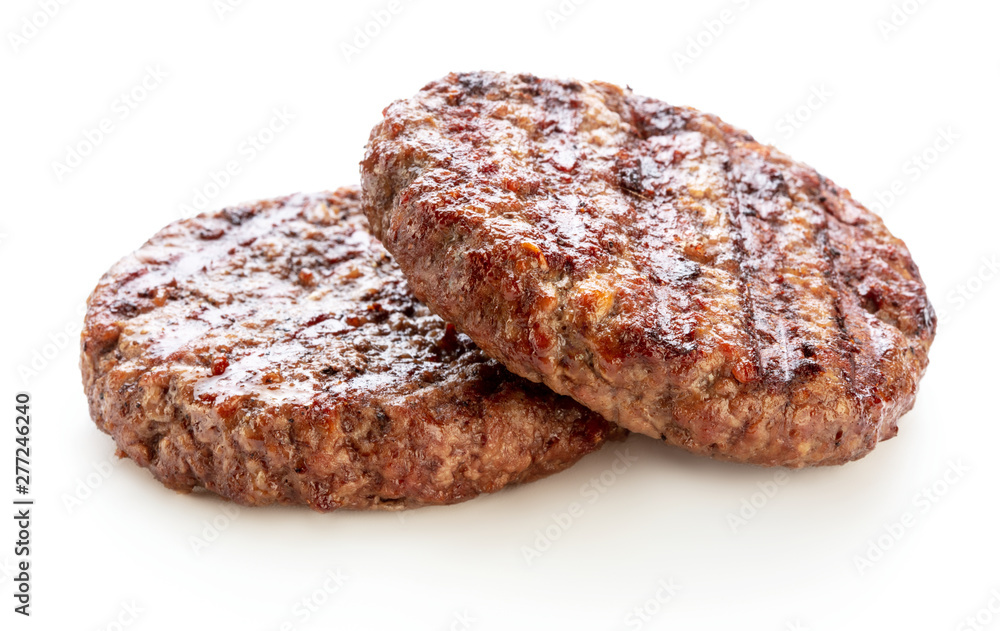 Fototapeta two piece of grilled ground beef meat for hamburger