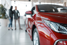 Couple Buying New Red Car In S...