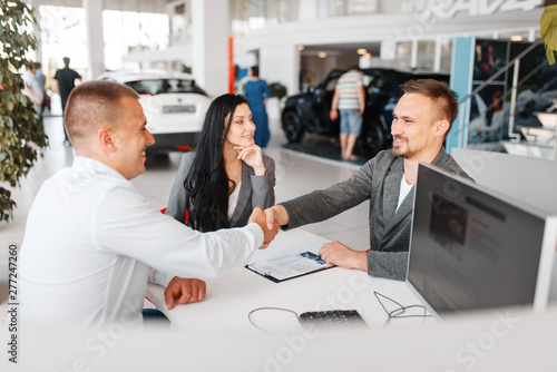 Fototapety, obrazy: Manager and couple make out the sale of a new car