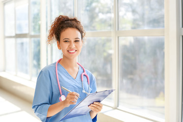 Young African-American nurse in clinic