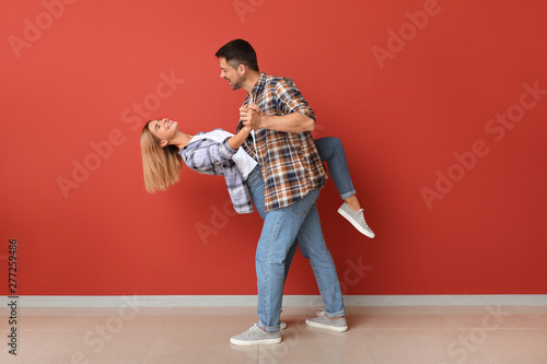 Deurstickers Dance School Portrait of dancing couple near color wall