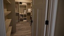 Walk Through Closet And Reveal Vanity Area. View Moves Through A Walk-in Closet And Reveals A Sitting Area With Vanity