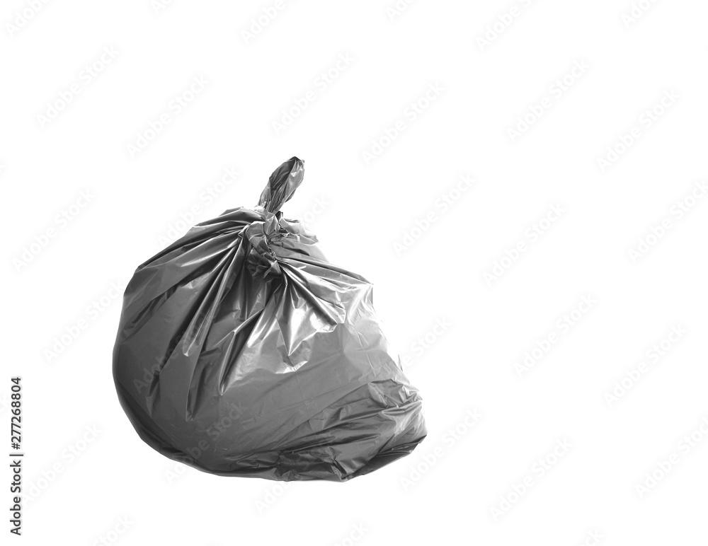 Fototapeta Black garbage bag isolated on white background.