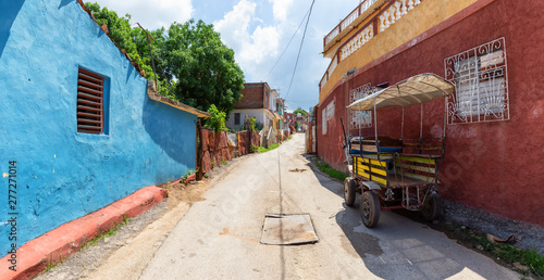 Panoramic view of a Residential neighborhood in a small Cuban Town during a cloudy and sunny day Wallpaper Mural
