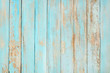 Leinwandbild Motiv Vintage beach wood background - Old weathered wooden plank painted in turquoise blue pastel color.