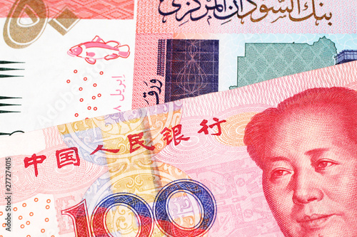 Cuadros en Lienzo A one hundred yuan, Chinese renminbi bill with a fifty pound note from Sudan clo