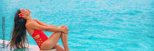 Obraz Swimsuit model beautiful natural beauty Asian woman with healthy long brown hair flowing in wind - wellness and spa banner panoramic on ocean blue beach background. - fototapety do salonu