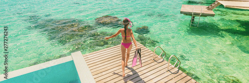 Poster Ecole de Danse Luxury Bora Bora resort woman going snorkeling from overwater bungalow panoramic. Tahiti paradise destination vacation.