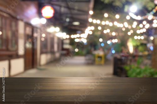 Fototapety, obrazy: Empty dark wooden table in front of abstract blurred bokeh background of restaurant . can be used for display or montage your products.Mock up for space.
