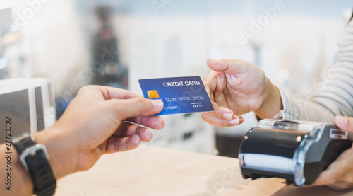 Customer using credit cart for payment to owner at cafe restaurant, cashless tec Canvas Print