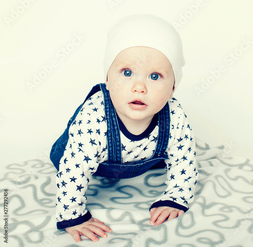 Obraz little cute baby toddler on carpet isolated close up smiling adorable cheerful - fototapety do salonu