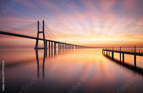 Obraz Lisbon bridge - Vasco da Gama at sunrise, Portugal - fototapety do salonu
