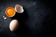 Organic Chicken Eggs On Dark Wooden Background With Copy Space.