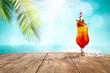 Summer drink sunrise on desk and beach landscape