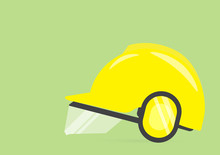 Safety First Concept With Yellow Helmet On Green