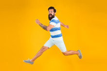 Summer Style. Sale And Discount. Hurry Up. Summer Vacation. Man Bearded Hipster With Mustache Long Beard Running Yellow Background. Guy Dressed Striped Shirt On Summer Vacation. Barbershop Concept