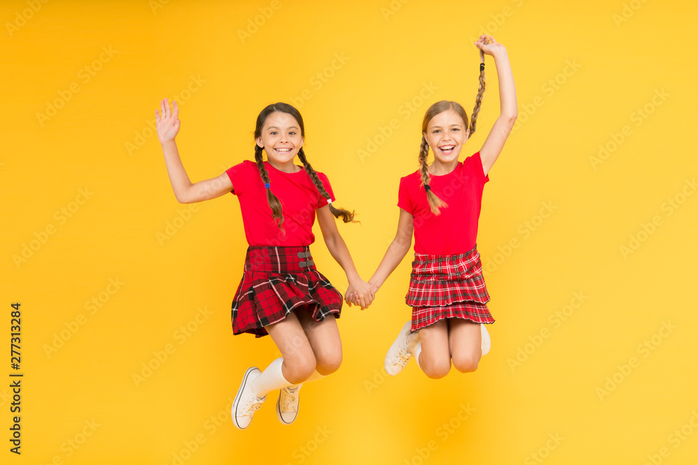 Fototapety, obrazy: Join celebration. Kids girl wear checkered dresses. National holiday. School uniform. Scottish style. Cheerful friends schoolgirls jumping yellow background. Celebrate holiday. Scottish holiday