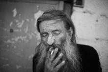 Close-up Shot Of An Old Homeless Man's Face