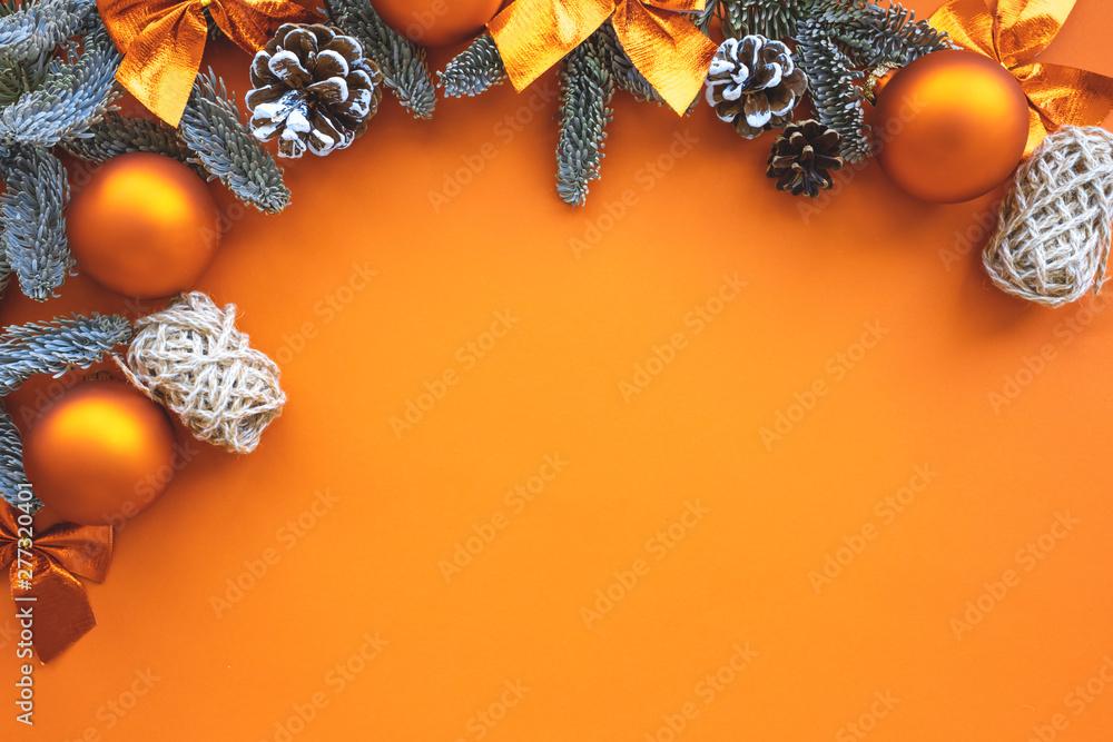 Fototapeta Christmas composition.  Background  orange colors with decorations.