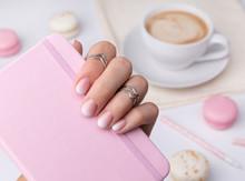 Beautiful Manicured Hand Holdi...