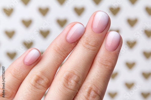 Aluminium Prints Manicure Hand with manicure at the creative background with hearts.