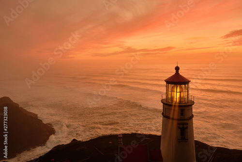Photo sur Toile Orange eclat Heceta Head Lighthouse at sunset, Pacific coast, built in 1892, Oregon, USA