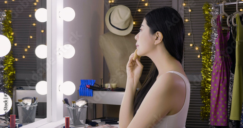 beautiful woman model makeup applying in dressing room backstage using cosmetic products Wallpaper Mural