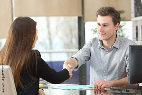 Valokuva  Serious businesspeople handshaking at office
