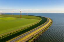 Wind Turbines In A Field In Th...