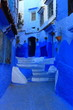 canvas print picture - Blue street walls of the popular city of Morocco, Chefchaouen. Traditional moroccan architectural details.