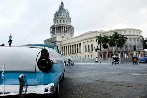 Old American blue car in the Paseo de Marti in Old Havana in Cuba near the Capit Fototapet