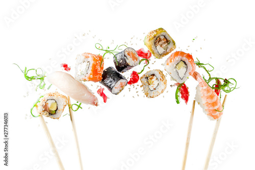 Seamless pattern with sushi. Food abstract background. Flying sushi, sashimi and rolls isolated on the white background.