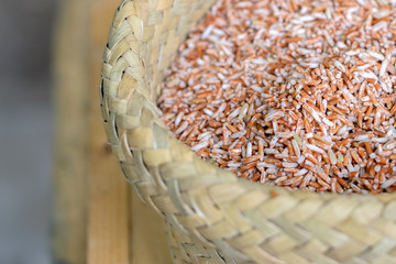 selective focus,Organic rice, brown rice in basketry on the wooden table background.