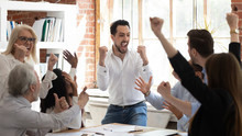 Euphoric Excited Business Team Celebrate Corporate Victory Together In Office