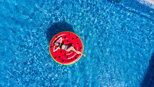 Young Pretty Woman Floating On The Inflatable Mattress Watermelon In Swimming Pool. Top View.