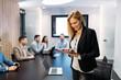 Leinwandbild Motiv Attractive businesswoman using digital tablet in office