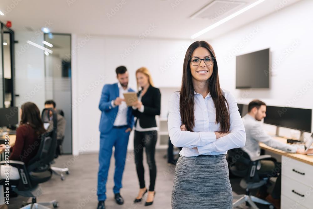 Fototapeta Portrait of successful beautiful businesswoman in office