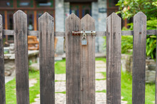 A Closed Gate Of Wooden Fence Of Backyard Garden