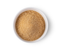 Brown Sugar In A Bowl Isolated On White Background. Top View