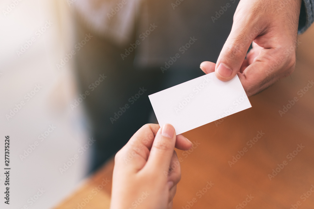 Fototapety, obrazy: Two businessman holding and exchanging empty business card